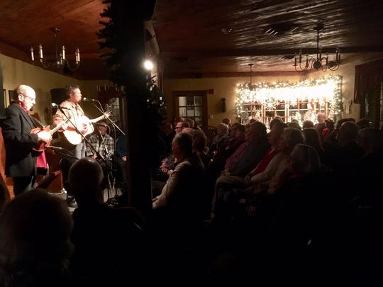 Singer-songwriter Robbie Fulks, right, and jazz mandolinist Don Stiernberg play before a packed house Jan. 5, 20108 at White Gull Inn for its winter acoustic music concert series.