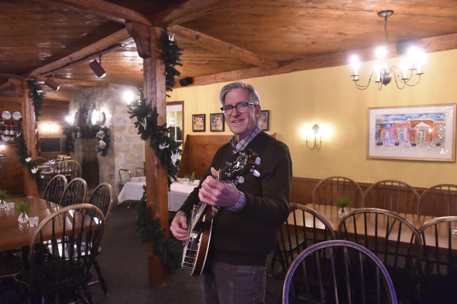 Andy Coulson of White Gull Inn in Fish Creek talked about 35 years of promoting acoustic concerts with dinner during the offseason at the inn.