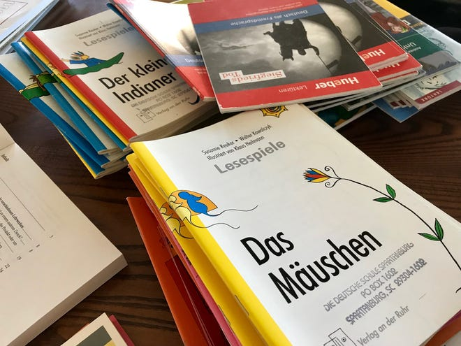 Stacks of German books cover a table during German School Upstate sessions on  Saturday, Nov. 17, 2018, at the Spartanburg Day School.