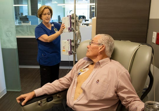Eric Kuhn talks with Joan Allen, a registered nurse, while getting his pre-chemo medications at St. Francis Cancer Center Tuesday, Dec. 18, 2018.
