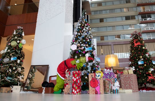 Trees decorated for 33rd annual Festival of Trees stand in the Hyatt Regency in Greenville Friday, Dec. 21, 2018.