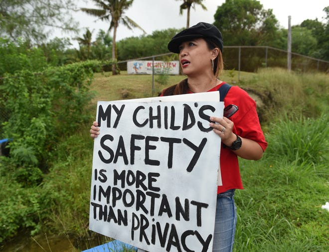 Brenda Acovera, whose son is an Oceanview Middle School seventh grader, protests with others for a safer learning environment and the revision of school policies outside the OMS campus in Agat, Dec. 21, 2018.