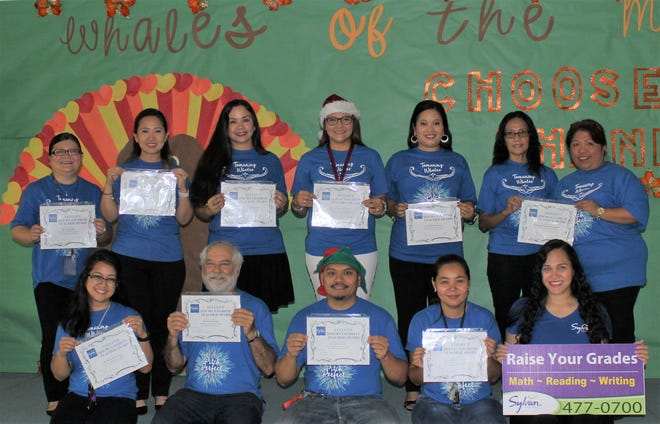 Congratulations to Tamuning Elementary School teachers who were voted as favorites by their students through Sylvan Learning Center's My Favorite Teacher. Tamuning Elementary School came in eighth place with the most student votes. Sylvan's Director, Crystal Nelson, presented each teacher with a certificate on November 30, 2018.  Top row from left: Lisa Gulac - second grade teacher, Lolita Chan -second grade teacher, Charlene Gumataotao - second grade teacher, Michelle Masnayon - third grade teacher, Mabel Unchangco - second grade teacher, Dr. Patricia Taitano- assistant principal, Josephine Parel-Fontbuena - assistant principal. Bottom row from left: Kimberly Garcia - fifth grade teacher, Jan Rudolph - fifth grade teacher, Linno Roxby - third grade teacher, Sharon Cabrera - fifth grade teacher.