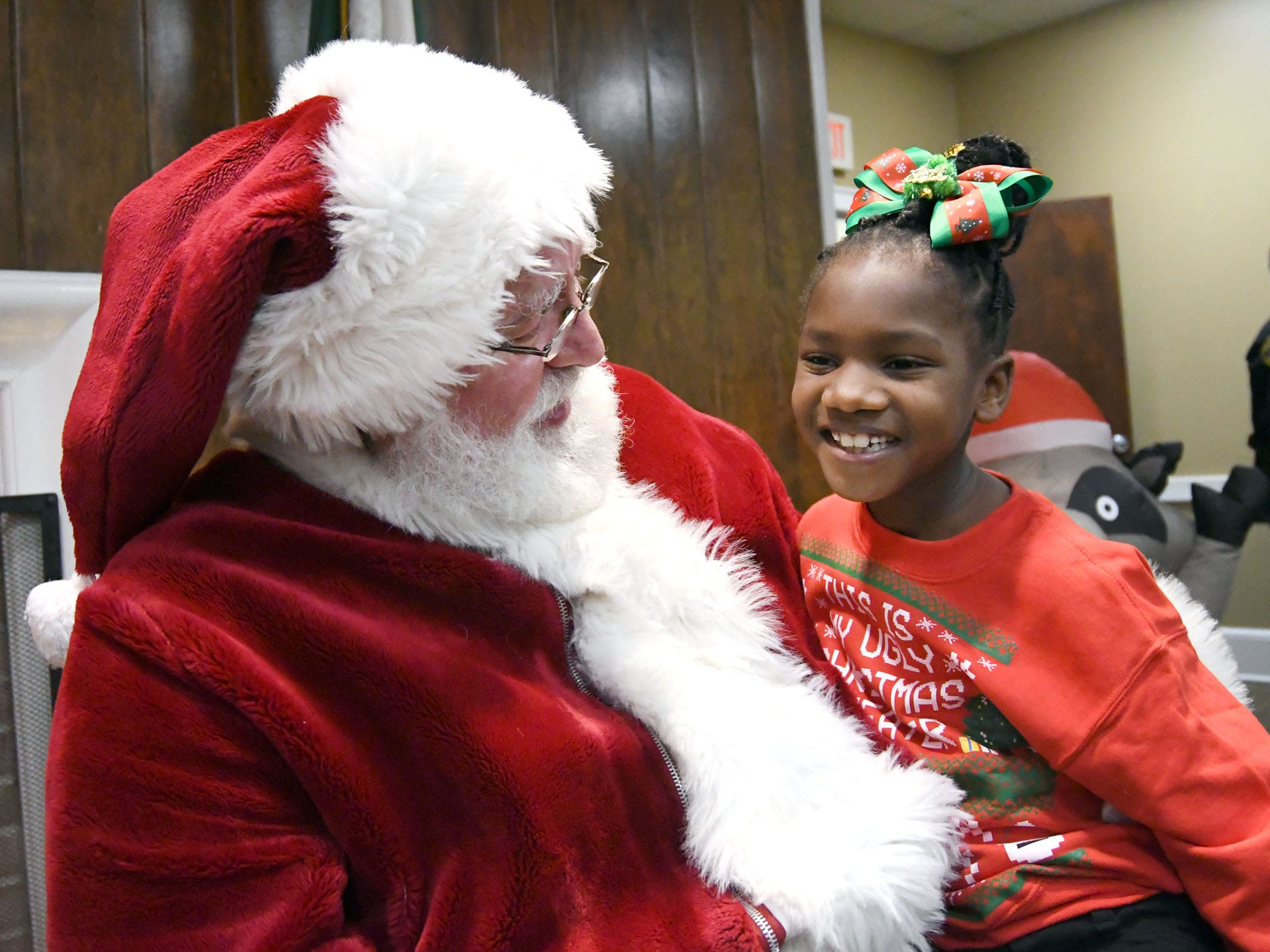 Kaitlyn Hawthorne talks to Santa Claus during the Hattiesburg Police Department's Victim Service Unit's Hearts of Hope Christmas party for victims affected by violent crimes at Jackie Sherrill Community Center on Thursday, December 20, 2018.