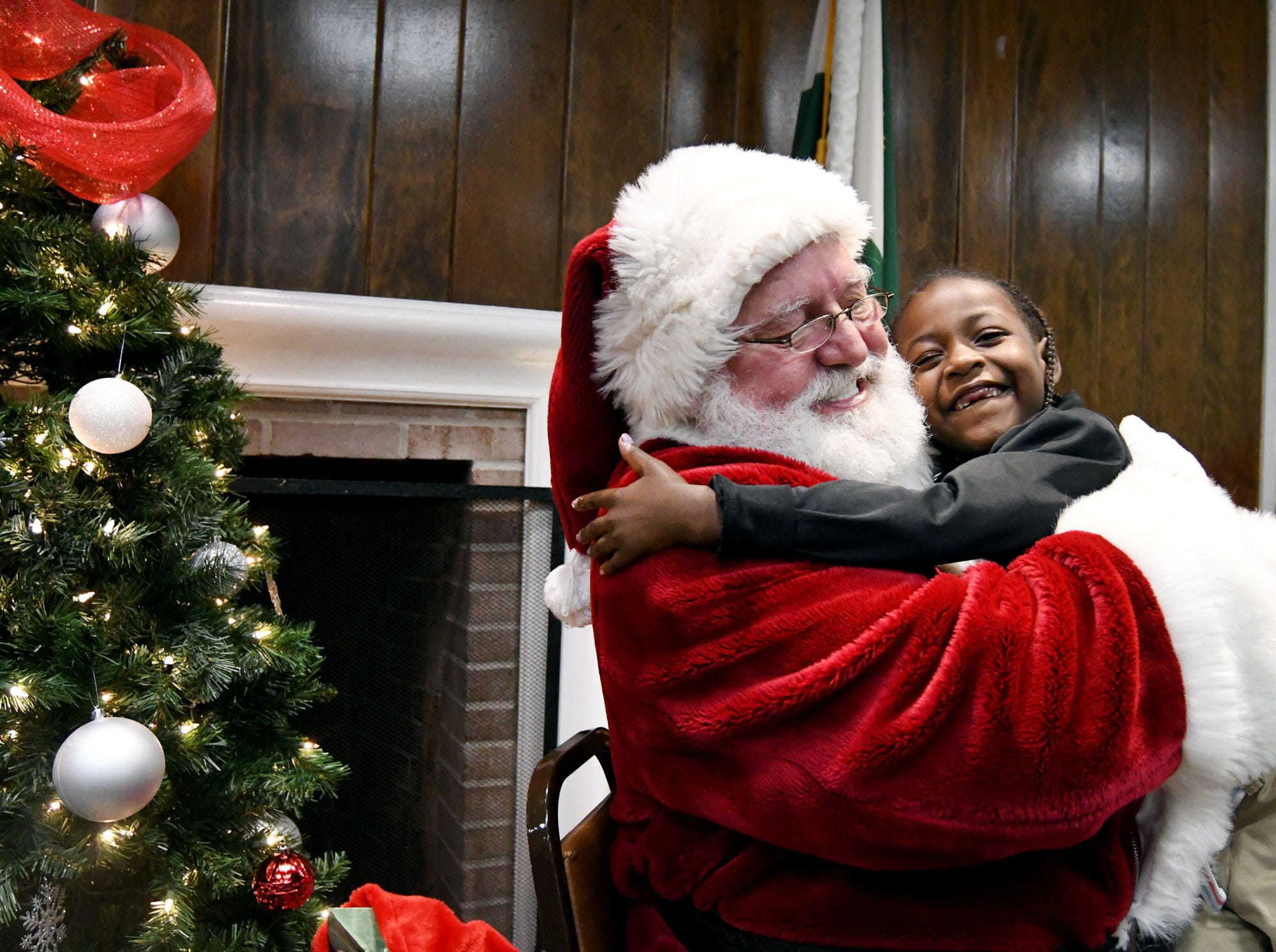 Kadence Brown, 4, hugs Santa Claus during the Hattiesburg Police Department's Victim Service Unit's Hearts of Hope Christmas party for victims affected by violent crimes at Jackie Sherrill Community Center on Thursday, December 20, 2018.