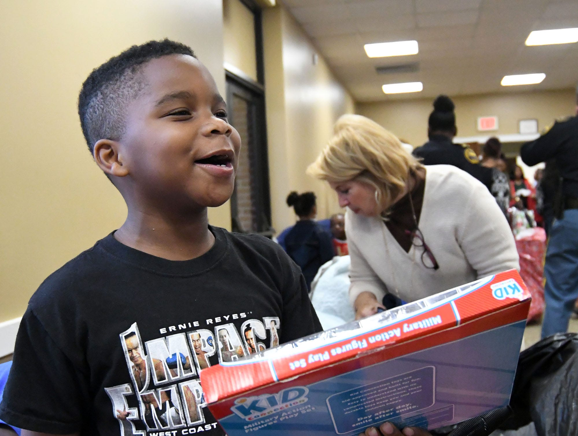 Jonathan Brown shows excitement while looking at his presents during the Hattiesburg Police Department's Victim Service Unit's Hearts of Hope Christmas party for victims affected by violent crimes at Jackie Sherrill Community Center on Thursday, December 20, 2018. Toys were donated through the Ryan's Chevrolet Stuff-a-Truck event and by the HPD Benevolent Fund.