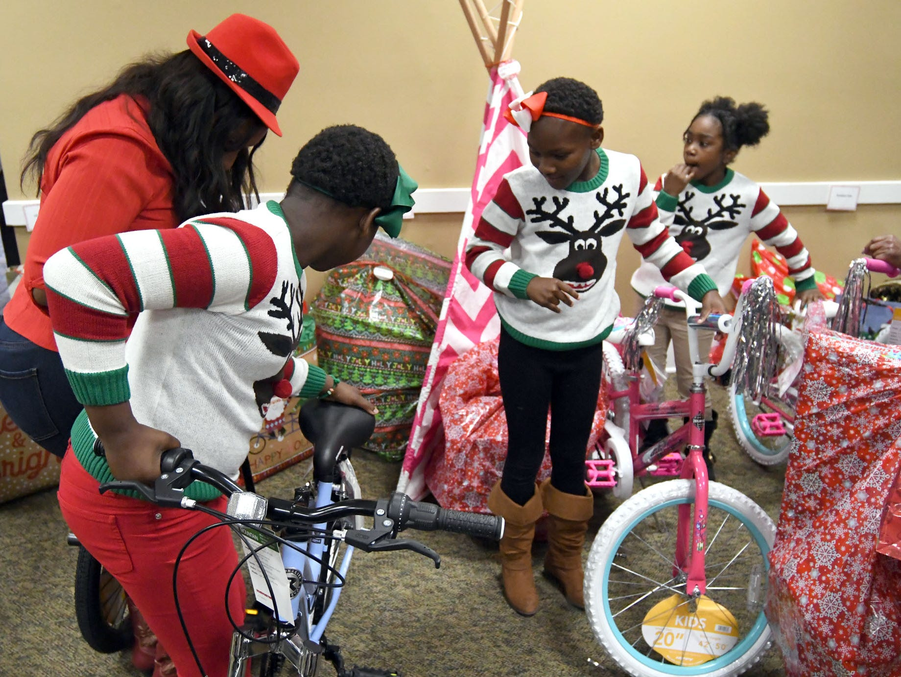 Children look at their new presents during the Hattiesburg Police Department's Victim Service Unit's Hearts of Hope Christmas party for victims affected by violent crimes at Jackie Sherrill Community Center on Thursday, December 20, 2018. Toys were donated through the Ryan's Chevrolet Stuff-a-Truck event and by the HPD Benevolent Fund.