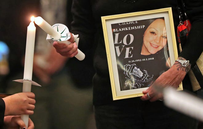 Carla Crosby holds a portrait of her late daughter, Chance Blankenship, who died in 2018.  Candles are lit and names of the homeless who died in 2018 are called, during the National Homeless Persons' Memorial Service at Roberts Park United Methodist Church, Friday, Dec. 21, 2018.