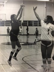 Kelly Krauskopf practices a shot in eighth grade. She would go on to play college basketball at Texas A&M.