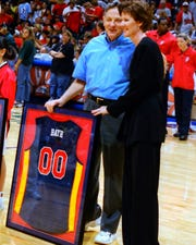 Kelly Krauskopf stands with former U.S. Sen. Birch Bayh at the inaugural Indiana Fever game in 2000.