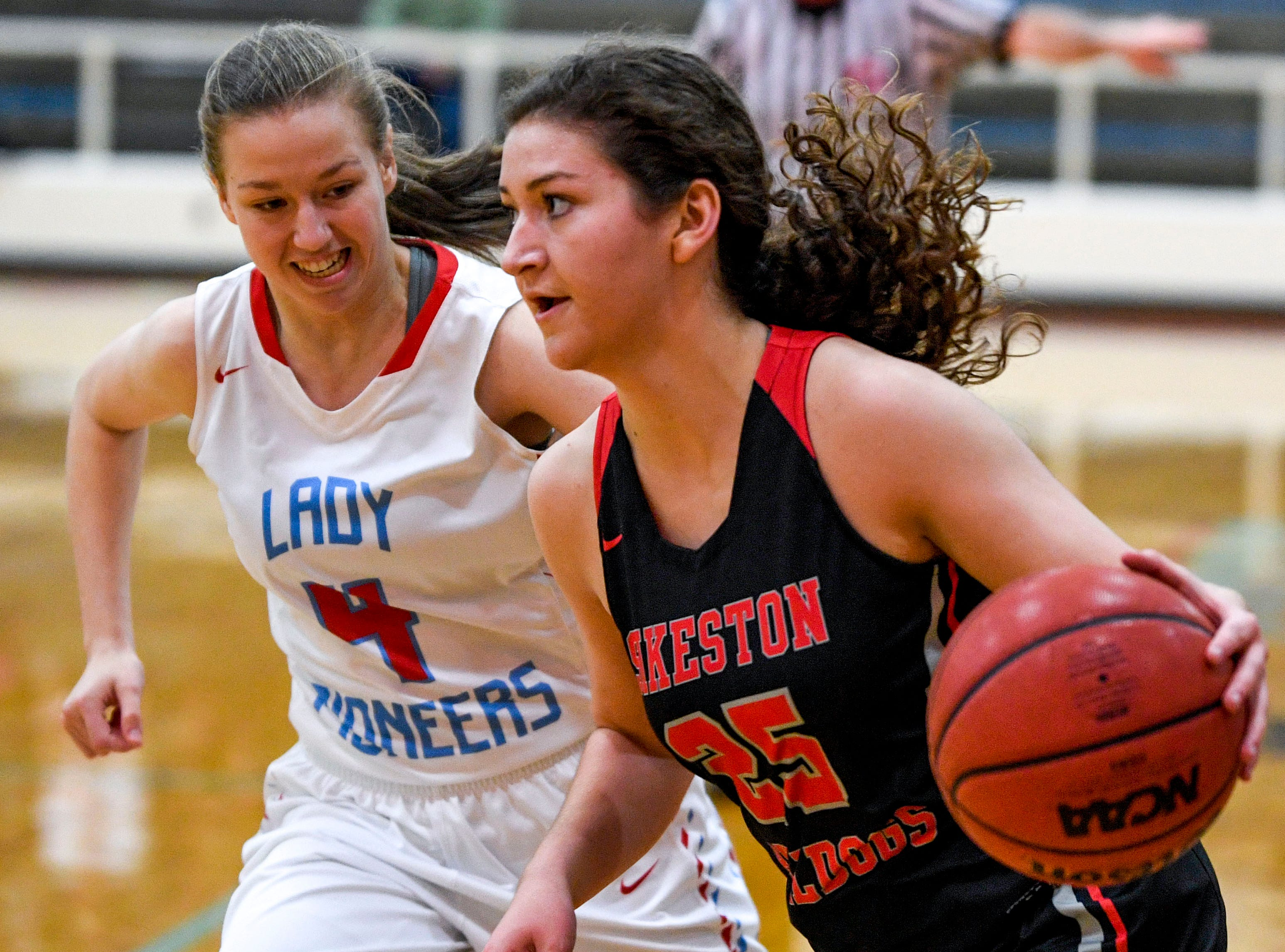 Sikeston's Sydney Stark (25) moves down the court with Gibson County' Annie Bass (4) right on her tail in a TSSAA girls basketball game between Gibson County and Sikeston (MO) in the Gibson County Christmas Tournament at Gibson County High School in Dyer, Tenn., on Thursday, Dec. 20, 2018.