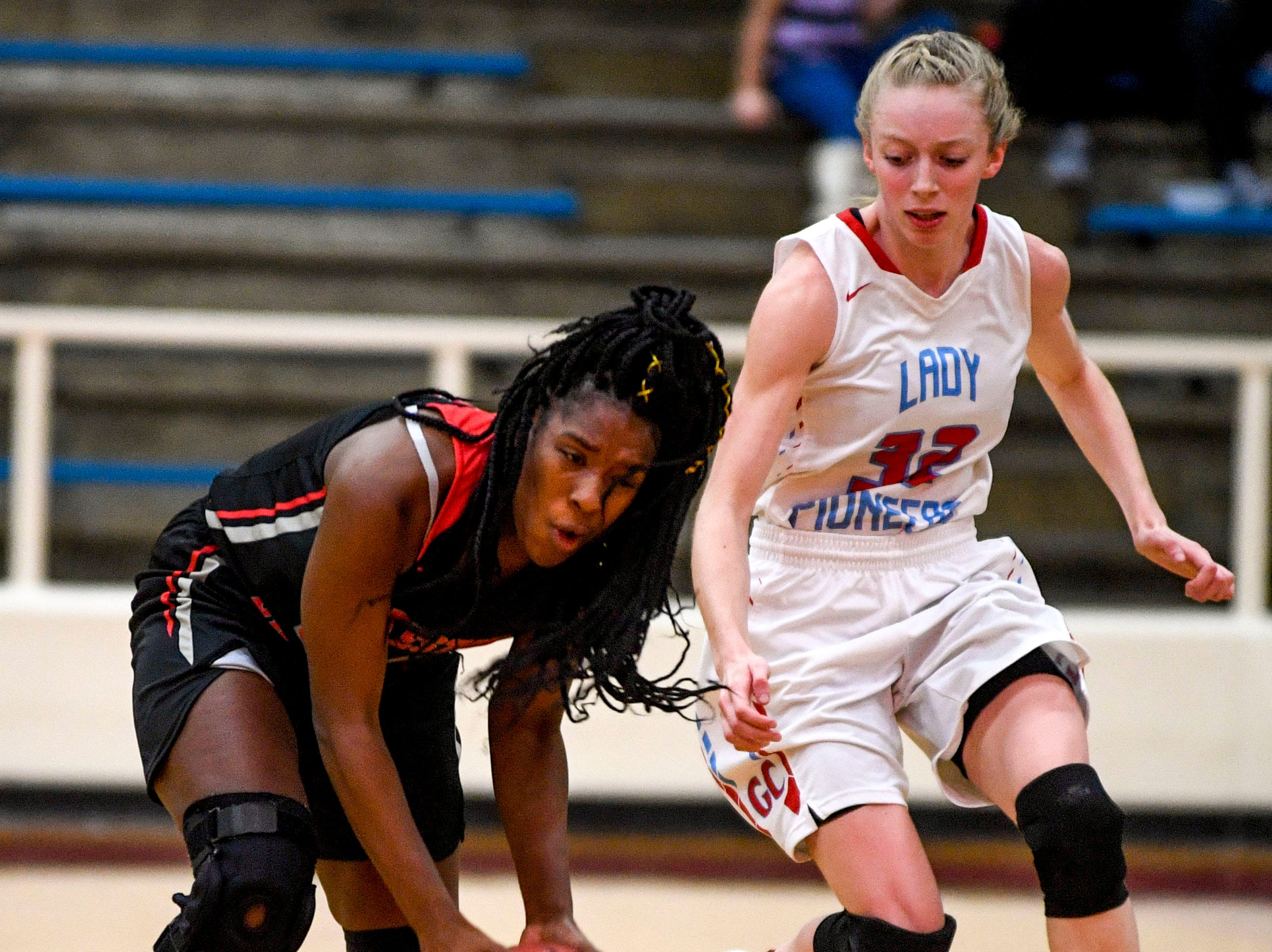 Sikeston's Taydrianna Barnett (20) tries to recover a lost ball before Gibson County's KJ White (32) can grab it in a TSSAA girls basketball game between Gibson County and Sikeston (MO) in the Gibson County Christmas Tournament at Gibson County High School in Dyer, Tenn., on Thursday, Dec. 20, 2018.