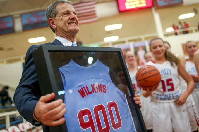 Gibson County head coach Mitch Wilkins holds out a special jersey with 900 on it commemorating his 900th winning game after a TSSAA girls basketball game between Gibson County and Sikeston (MO) in the Gibson County Christmas Tournament at Gibson County High School in Dyer, Tenn., on Thursday, Dec. 20, 2018.