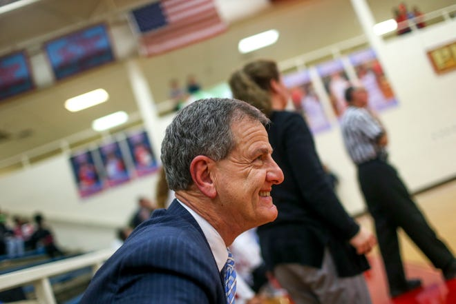Mitch Wilkins, head coach of Gibson County, smiles as he stands up at the buzzer for his 900th winning game in a TSSAA girls basketball game between Gibson County and Sikeston (MO) in the Gibson County Christmas Tournament at Gibson County High School in Dyer, Tenn., on Thursday, Dec. 20, 2018.