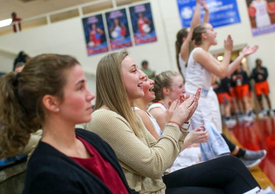 Gibson County assistant coach Erin Lannom cheers on one of the younger players making a shot in a TSSAA girls basketball game between Gibson County and Sikeston (MO) in the Gibson County Christmas Tournament at Gibson County High School in Dyer, Tenn., on Thursday, Dec. 20, 2018.