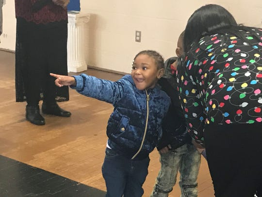 One child points at another child who got a coat while trying on her own at Washington-Douglass on Thursday.