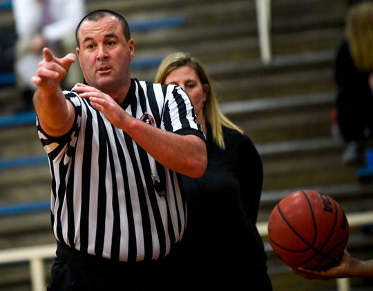 A referee motions a call to the players in a TSSAA girls basketball game between Gibson County and Sikeston (MO) in the Gibson County Christmas Tournament at Gibson County High School in Dyer, Tenn., on Thursday, Dec. 20, 2018.