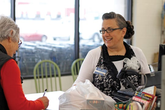 Christine McCrury has been 'rescued' by Goodwill in Lexington more than once. Now, she gives back.