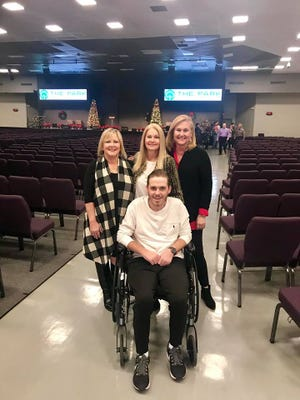 Slater Springman stops for a picture with his mother, Rexann, and a couple of his aunts, Dec. 16, 2018, after his first time back at church since summer.