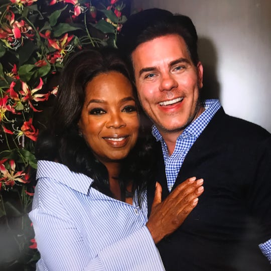 Oprah Winfrey and Stephen Brown pose for a photo in Alaska during a shoot for a December 2017 edition of The Oprah Magazine.