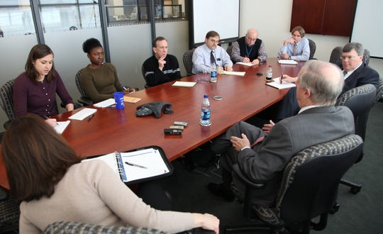 Gov. Phil Bredesen, second from right, talks with News Sentinel staff members Chloe Kennedy, Lola Alapo, editor Jack McElroy, Roger Harris, Hoyt Canady, John North, and publisher Patrick Birmingham, second from left to right, as press secretary Lydia Lenker, left, looks on Friday, Jan. 8, 2010.  A special legislative session will take place in Nashville on Jan. 12.