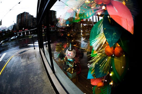 Glittery crafts and decorations can be seen through the windows of downtown Knoxville's Glitterville studio, which recently opened in the Keener building.