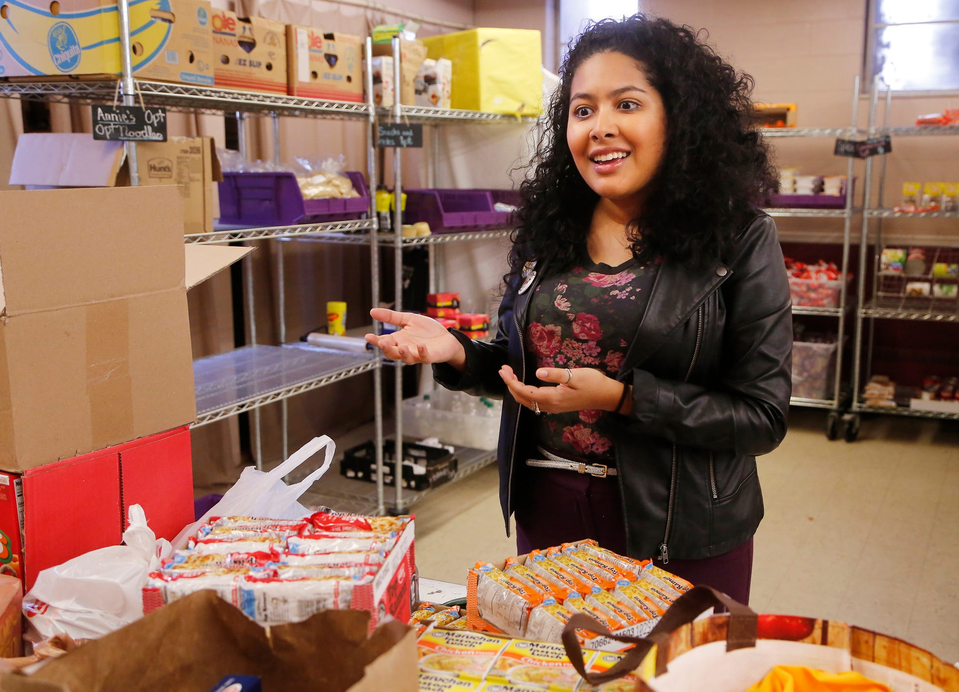 Vanessa Pacheco talks about the work by the ACE Campus Food Pantry to help address issues of food insecurity among Purdue University students, faculty and staff Wednesday, December 19, 2018, at the Baptist Student Foundation, 100 N. Russell Street in West Lafayette. Pacheco is coordinator for civic engagement at Purdue. She is also staff advisor at ACE Campus Food Pantry.