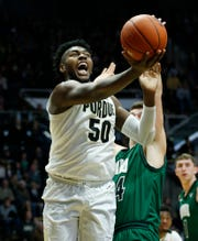 Trevion Williams of Purdue spins to put up a shot against Mason McMurray of Ohio Thursday, December 20, 2018, at Mackey Arena. Purdue defeated Ohio 95-67.