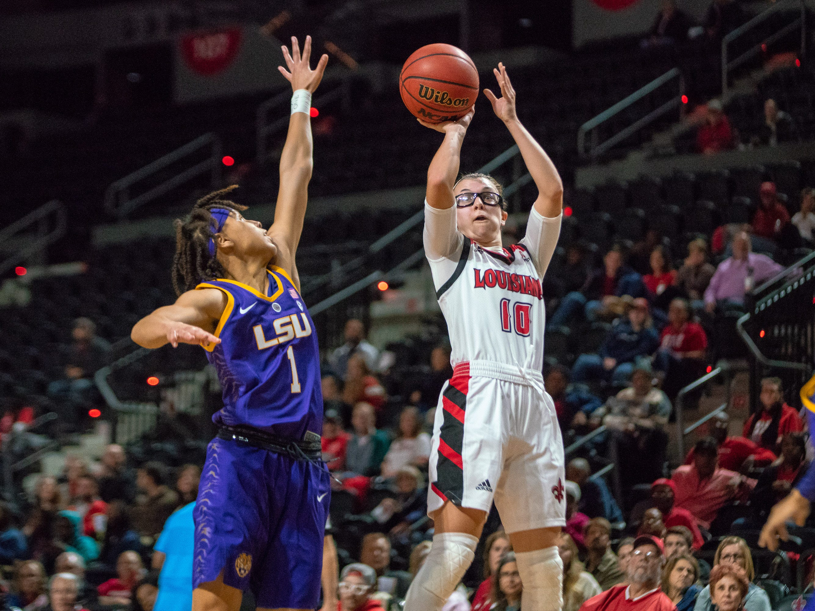 UL's Andrea Cournoyer shoots to score as the Ragin' Cajuns play against LSU Tigers at the Cajundome on Dec. 20, 2018.
