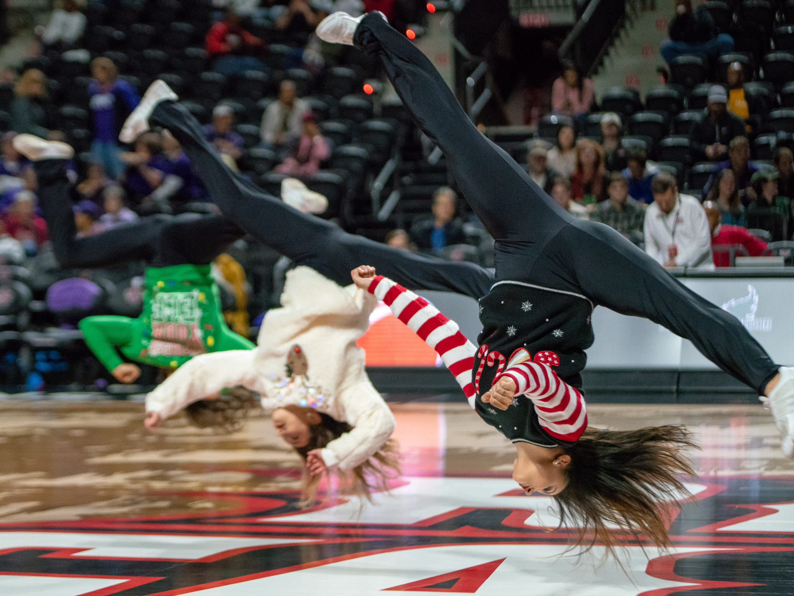 The Ragin' Jazz perform their routine at half-time as the Ragin' Cajuns play against LSU Tigers at the Cajundome on Dec. 20, 2018.