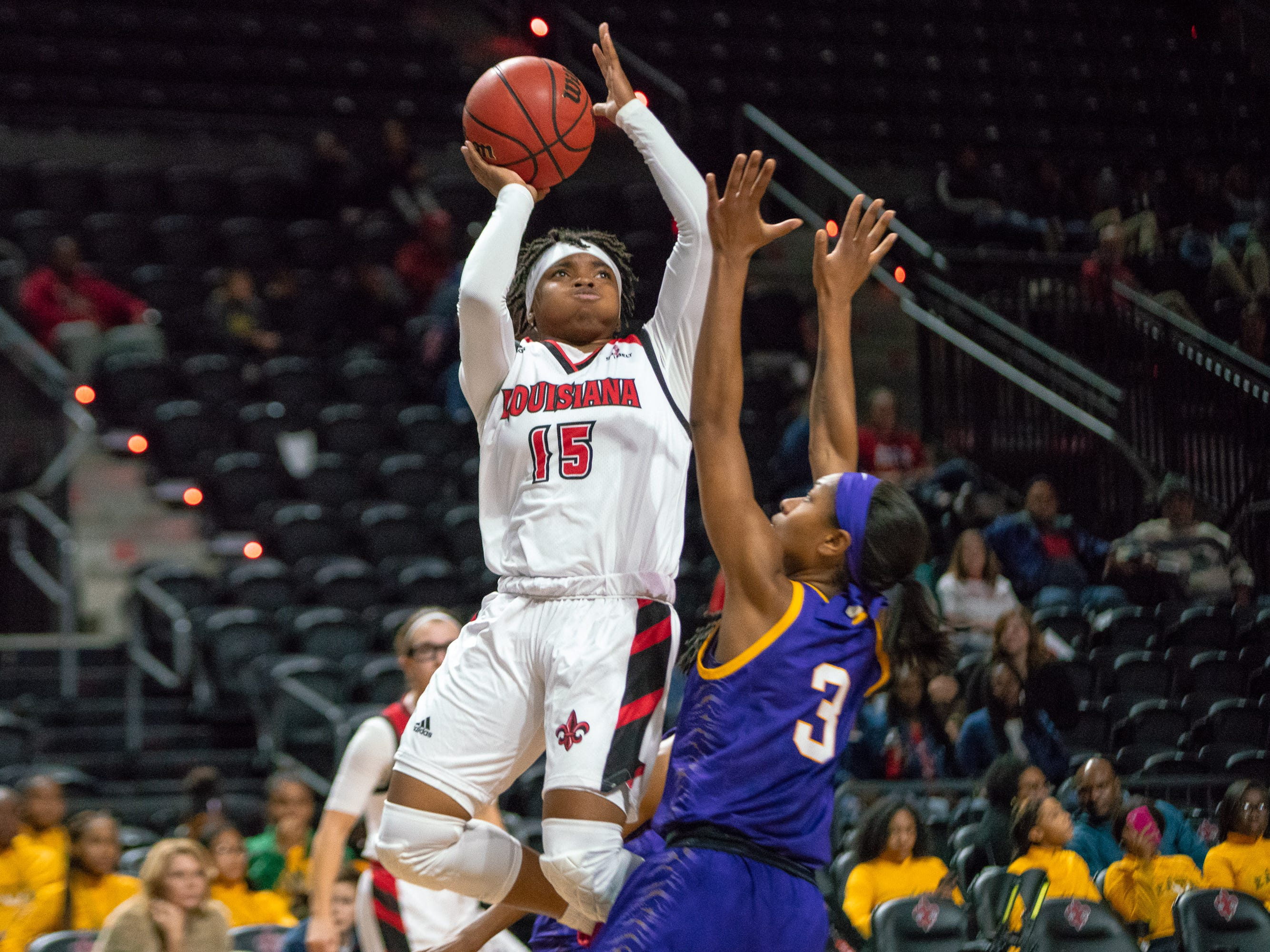 UL's Diamond Morrison shoots over a defender as the Ragin' Cajuns play against LSU Tigers at the Cajundome on Dec. 20, 2018.