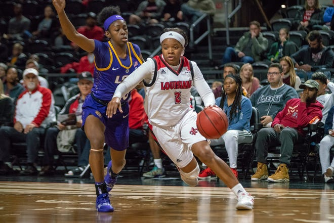 UL's Brandi Williams drives the ball towards the basket as the Ragin' Cajuns play against LSU Tigers at the Cajundome on Dec. 20, 2018.
