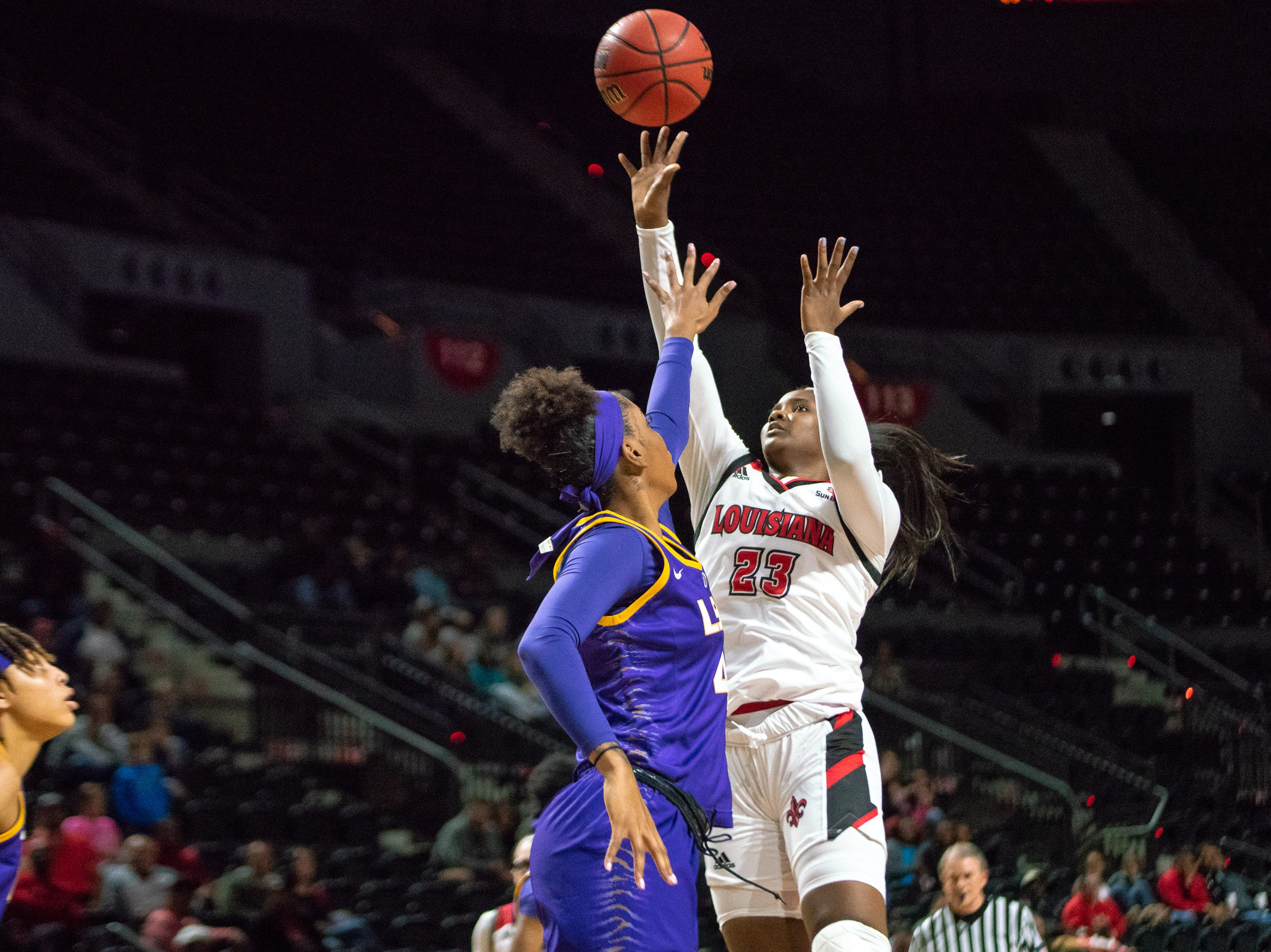 UL's Kristen Daniels shoots over a defender during the play as the Ragin' Cajuns play against LSU Tigers at the Cajundome on Dec. 20, 2018.