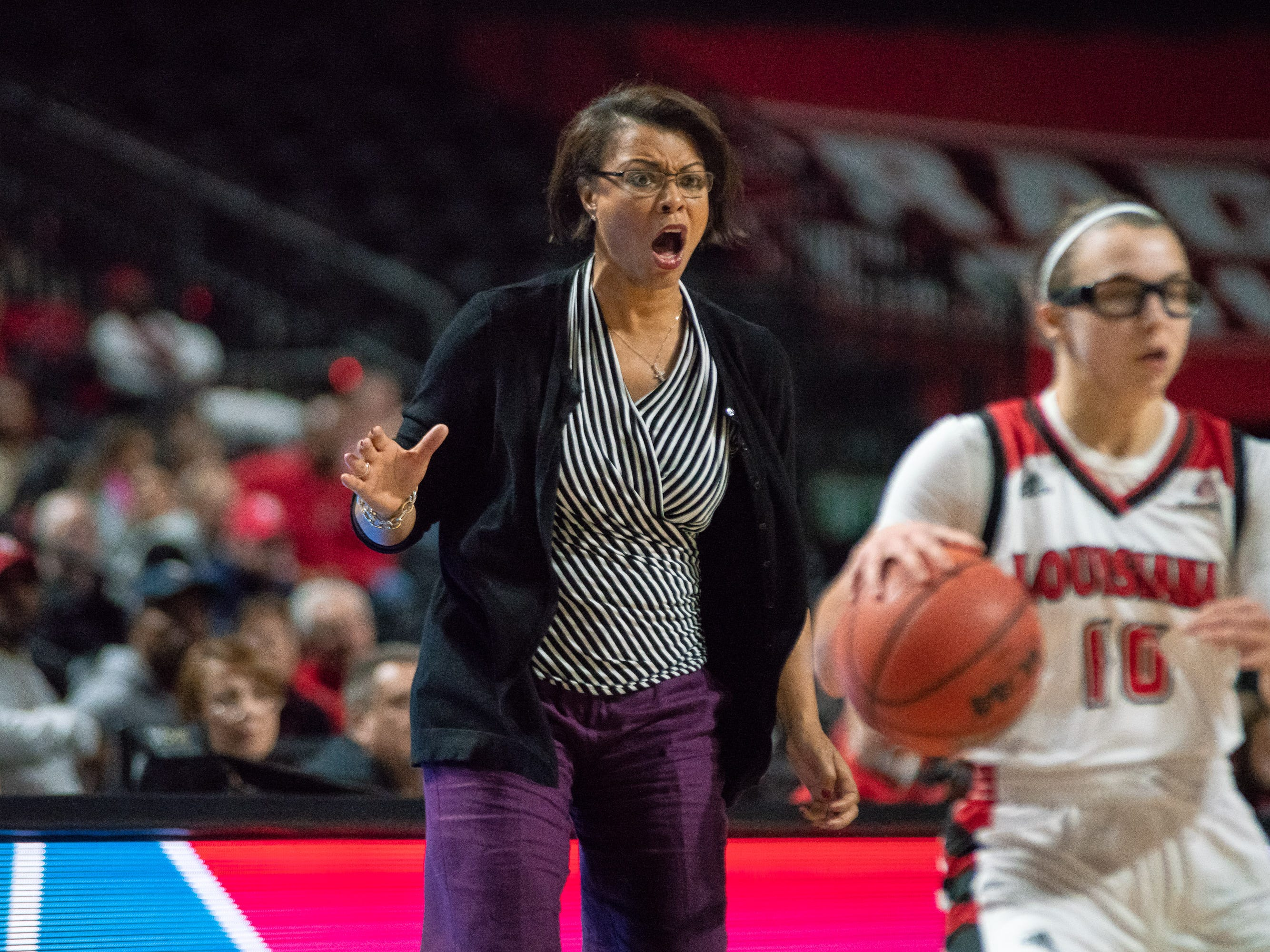 LSU's head coach Nikki Fargas calls out to the defense from the sidelines as the Ragin' Cajuns play against LSU Tigers at the Cajundome on Dec. 20, 2018.