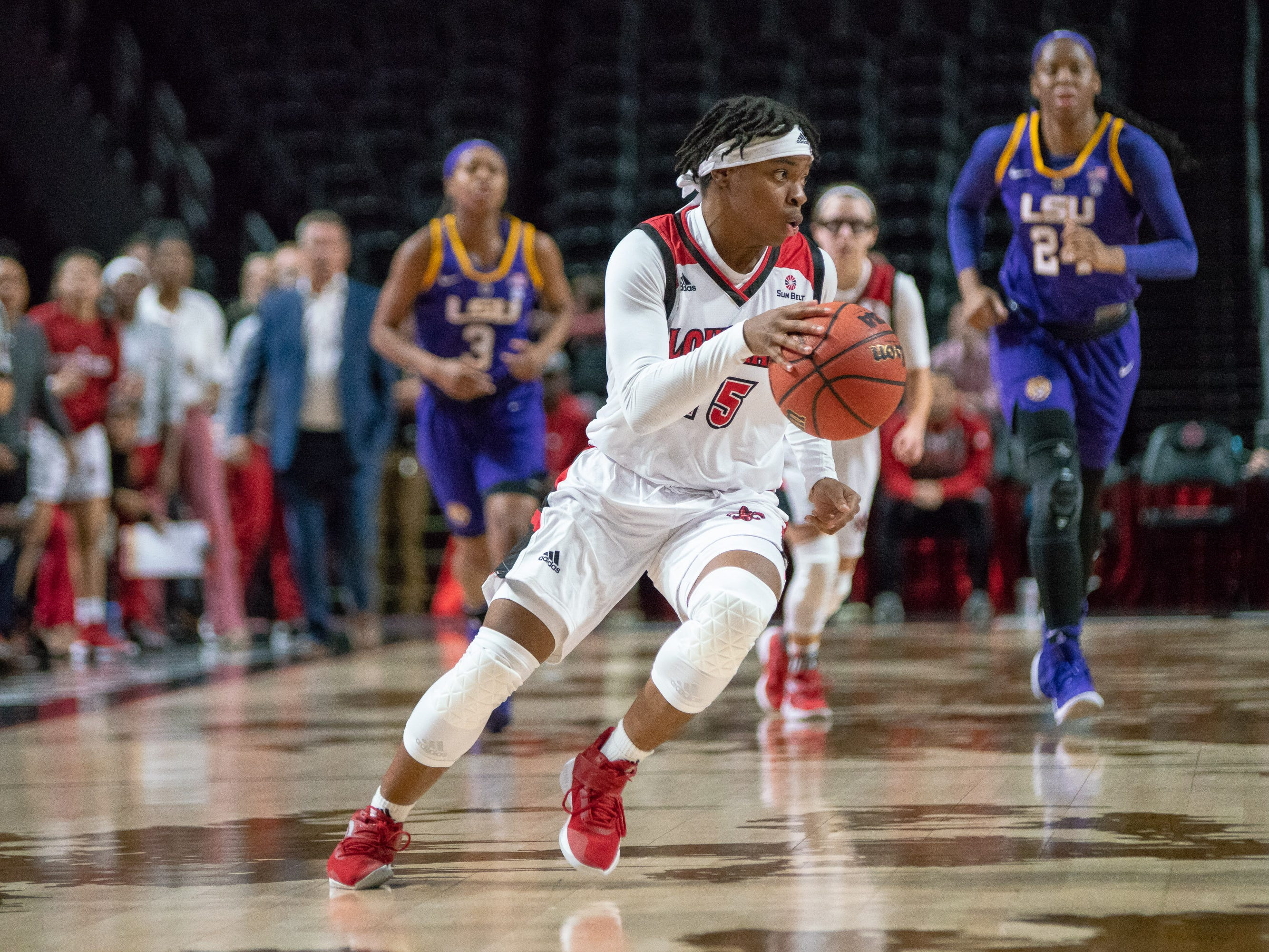 UL's Diamond Morrison moves the ball down the court as the Ragin' Cajuns play against LSU Tigers at the Cajundome on Dec. 20, 2018.
