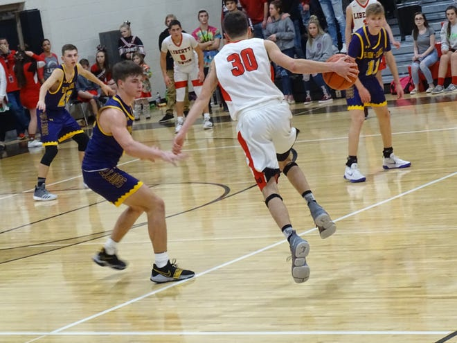 Liberty Union's Hunter Antritt gets set to make a move on Bloom-Carroll's Otto Kuhns during the Lions' 74-53 Mid-State League-Buckeye Division win Thursday night.