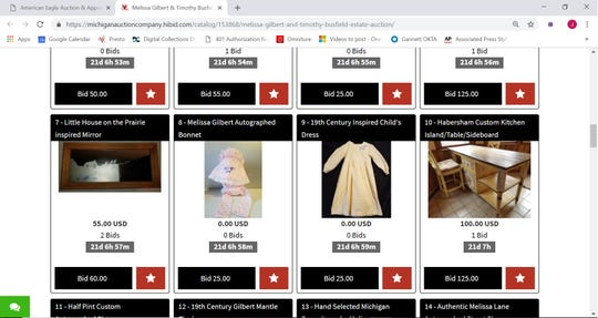 """A screenshot taken Friday, Dec. 21, 2018 of an online auction catalog of items belonging to famous actors Melissa Gilbert and Timothy Busfield shows a bonnet and dress Gilbert wore while acting in """"Little House on the Prairie"""" and other items."""