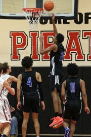 Emoni Bates puts in two of his game-high 32 points for Ypsilanti Lincoln in a 75-53 victory at Pinckney on Thursday, Dec. 20, 2018.