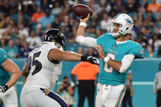 Baltimore Ravens defensive end Zach Sieler (95), a Pinckney graduate, pressures Miami Dolphins quarterback Brock Osweiler during a preseason game on Aug. 25, 2018.