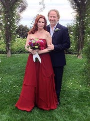The red dress actress Melissa Gilbert wore at her wedding to actor-director Timothy Busfield is among more than 200 personal possessions in an online auction.