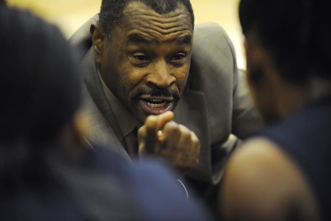 Fairdale Girl's Basketball Coach Al Northington talks with his players during a timeout against Iroquois at Iroquois High School on Tuesday. (By David Lee Hartlage, special to The Courier-Journal) Jan. 19, 2010