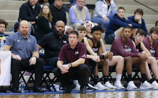 The Madisonville bench against Fairdale during the King of the Bluegrass tournament at Fairdale High School.  Dec. 20, 2018