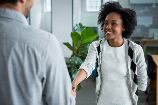 Happy Woman Shaking Hands With Colleague
