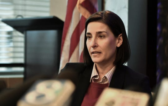 Assistant Attorney General Christina Grossi answers questions, Friday, Dec. 21, 2018, during a press conference regarding the independent Special Counsel's investigation into MSU's handling of the Larry Nassar matter.  [AP Photo/Matthew Dae Smith/Lansing State Journal]