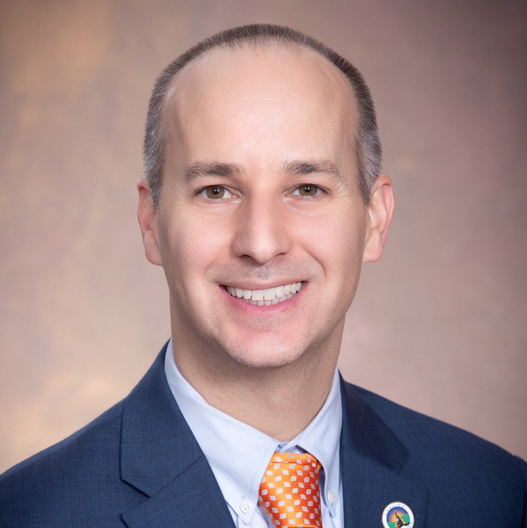 Lansing Mayor Andy Schor issues first veto over neighborhood funding in budget