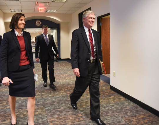 From left.  Assistant Attorney General Christina Grossi, Special Agent David Dwyre, and Special Prosecutor Bill Forsyth head in for a press conference, Friday, Dec. 21, 2018, at the Office of the Attorney General, regarding MSU's handling of the Nassar matter.  [AP Photo/Matthew Dae Smith/Lansing State Journal]