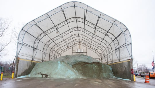 Road salt is piled up an Ingham County Road Commission storage facility at Aurelius Road in Lansing  on Thursday, Dec. 20, 2018.