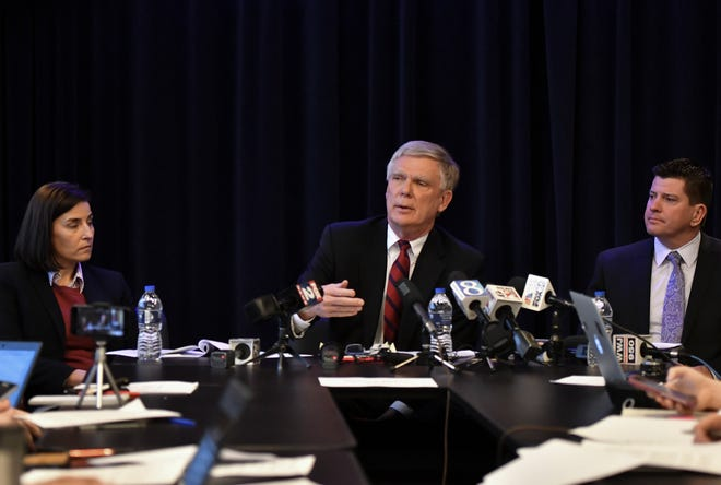 Special Prosecutor Bill Forsyth, middle, answers questions, Friday, Dec. 21, 2018, during a press conference regarding the independent Special Counsel's investigation into MSU's handling of the Larry Nassar matter. Also pictured are Assistant Attorney General Christina Grossi, left, and Special Agent David Dwyre.  [AP Photo/Matthew Dae Smith/Lansing State Journal]