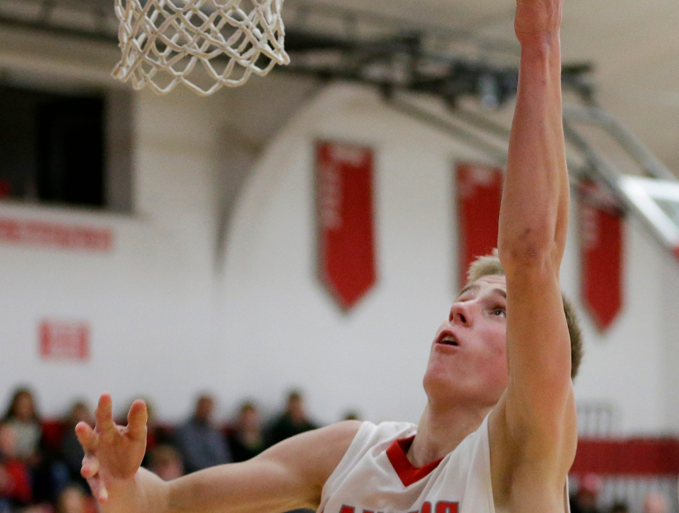 Manitowoc Lutheran's Evan Lischka takes it to the hoop against Reedsville at Manitowoc Lutheran High School Thursday, December 20, 2018, in Manitowoc, Wis. Joshua Clark/USA TODAY NETWORK-Wisconsin