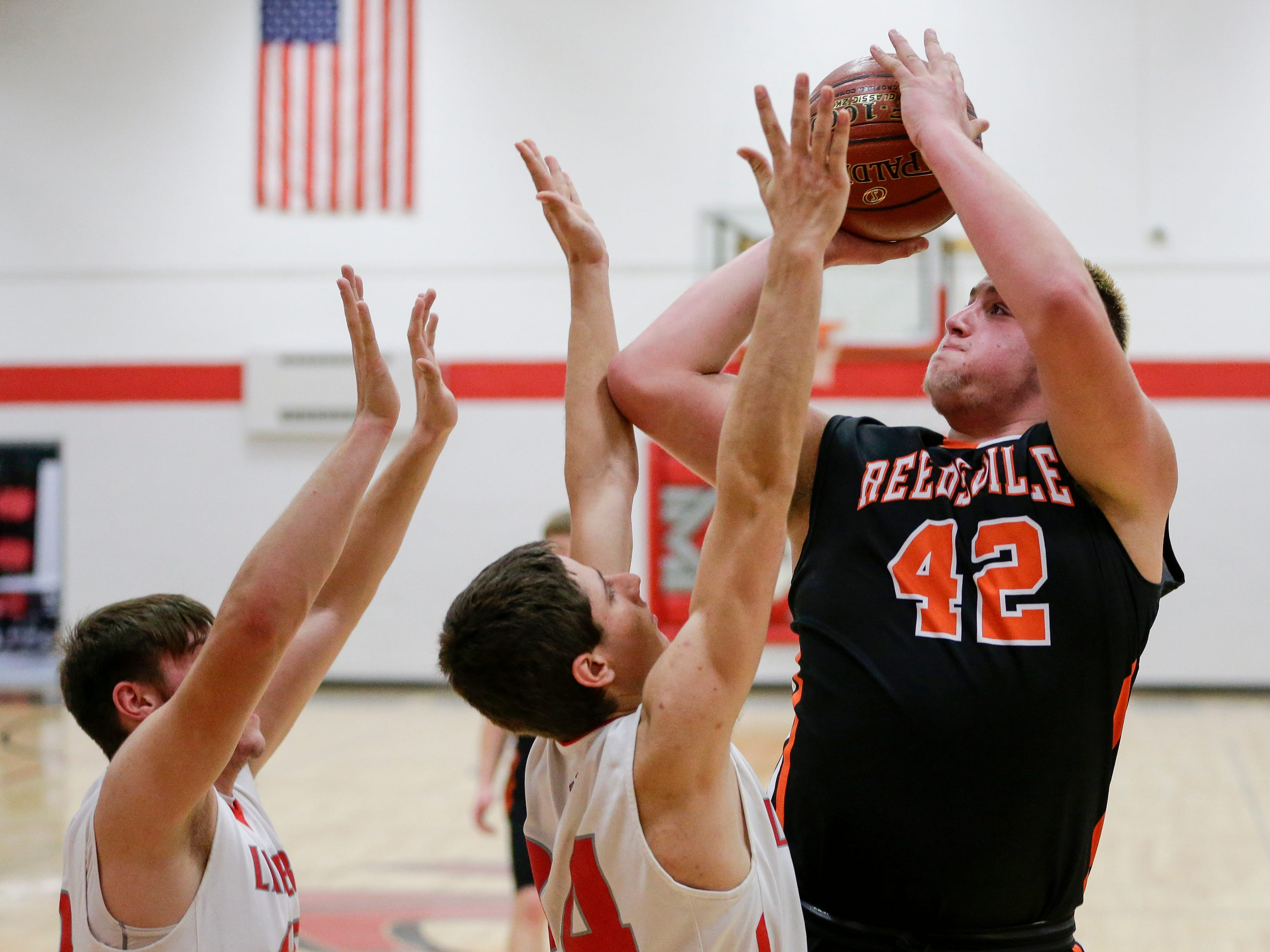 Reedsville's Austin Schmidt puts up a short jump shot against Manitowoc Lutheran at Manitowoc Lutheran High School Thursday, December 20, 2018, in Manitowoc, Wis. Joshua Clark/USA TODAY NETWORK-Wisconsin